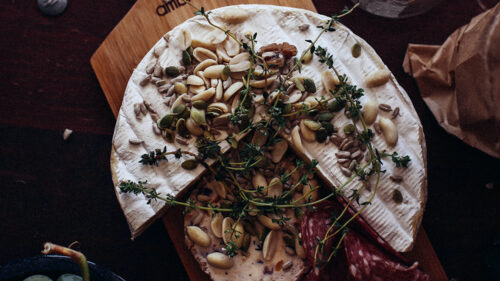 Baked Brie with Roasted Cranberries, Pistachio and Fresh Basil